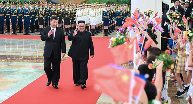 习近平同朝鲜劳动党委员长金正恩  举行会谈